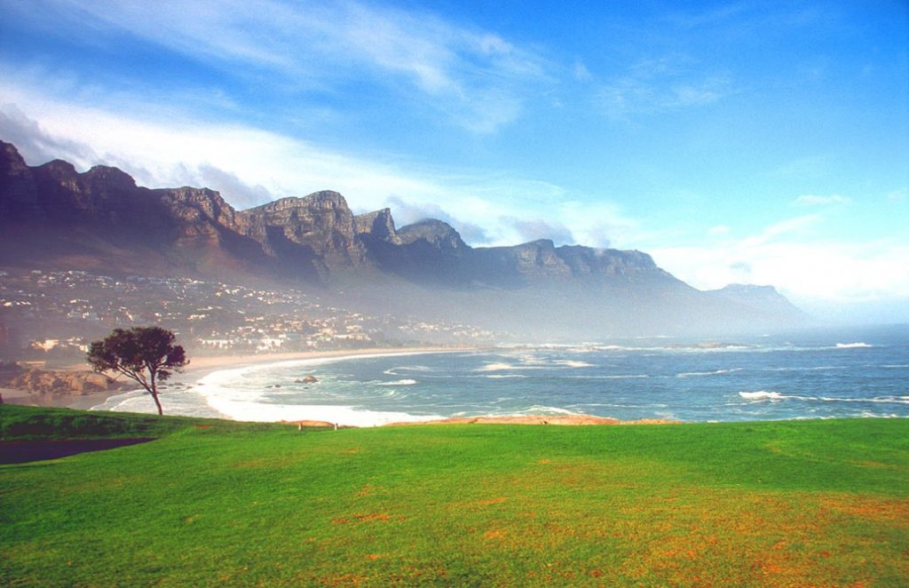 CPT Camps Bay beach with Twelve Apostles mountains in the morning b